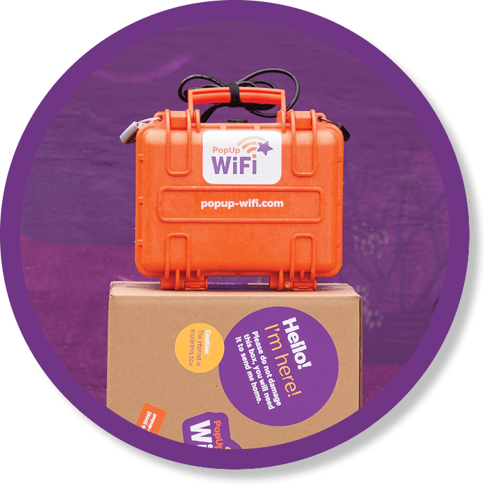 Image of PopUp WiFi's Go HD unit sitting on a packing box